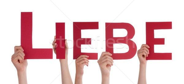 Hands Holding the Word Liebe Stock photo © Nelosa