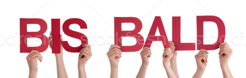 People Holding Straight German Word Bis Bald Means Goodbye Stock photo © Nelosa
