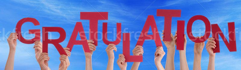 People Holding German Word Gratulation Means Congratulation Blue Stock photo © Nelosa