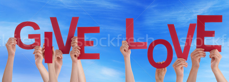 People Hands Holding Red Word Give Love Blue Sky Stock photo © Nelosa