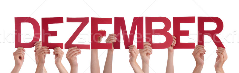 People Holding Straight German Word Dezember Means December Stock photo © Nelosa