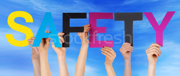 Many People Hands Holding Colorful Straight Word Safety Blue Sky Stock photo © Nelosa