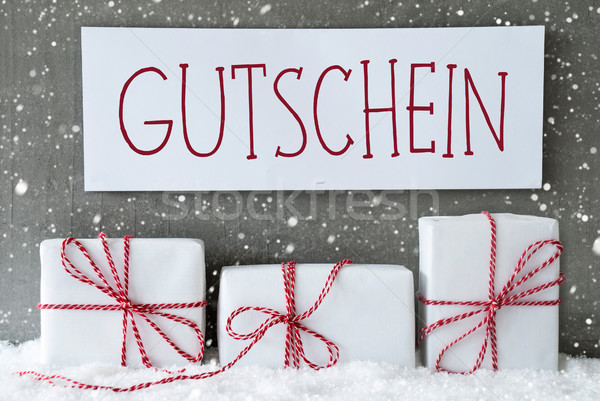 Stock photo: White Gift With Snowflakes, Gutschein Means Voucher