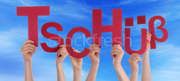 People Hold German Word Tschuess Mean Bye Blue Sky Stock photo © Nelosa