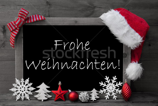 Blackboard Santa Hat Frohe Weihnachten Means Merry Christmas  Stock photo © Nelosa