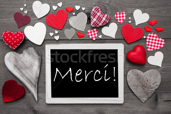 Chalkbord With Many Red Hearts, Merci Means Thank You Stock photo © Nelosa