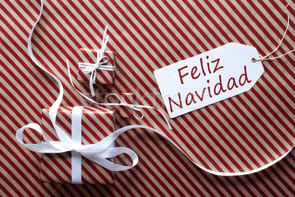 Two Gifts With Label, Feliz Navidad Means Merry Christmas Stock photo © Nelosa