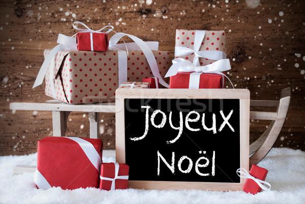Sleigh With Gifts, Snow, Snowflakes, Joyeux Noel Means Merry Christmas Stock photo © Nelosa