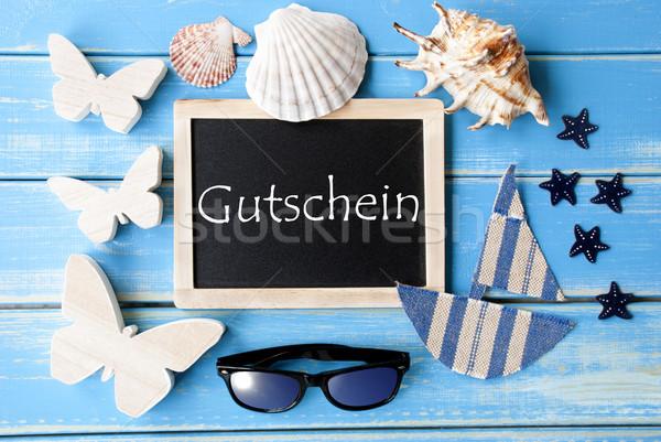 Blackboard With Maritime Decoration, Gutschein Means Voucher Stock photo © Nelosa