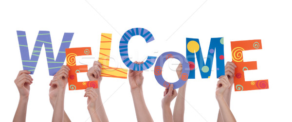 Hands Holding Welcome Stock photo © Nelosa