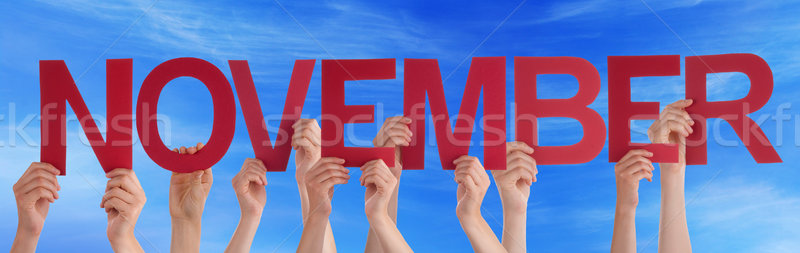 Hands Holding Red Straight Word November Blue Sky Stock photo © Nelosa