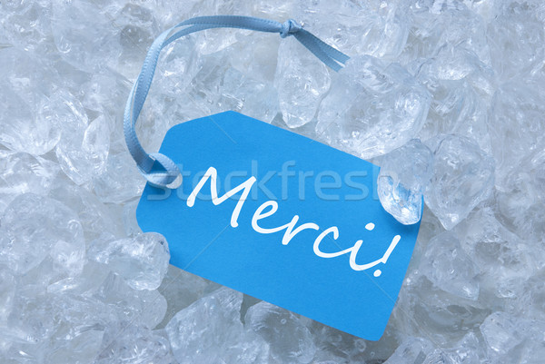 Label On Ice With Merci Means Thank You Stock photo © Nelosa