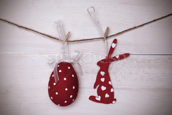 One Red Easter Bunny And Easter Egg Hanging On Line With Frame Stock photo © Nelosa
