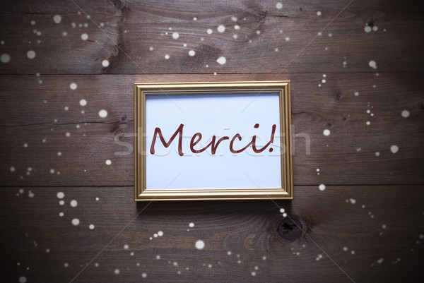 Golden Picture Frame With Merci Means Thank You And Snowflakes Stock photo © Nelosa