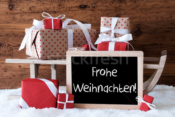 Sleigh With Gifts On Snow, Frohe Weihnachten Means Merry Christm Stock photo © Nelosa
