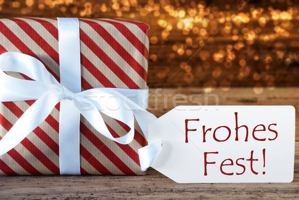 Atmospheric Gift With Label, Frohes Fest Means Merry Christmas Stock photo © Nelosa