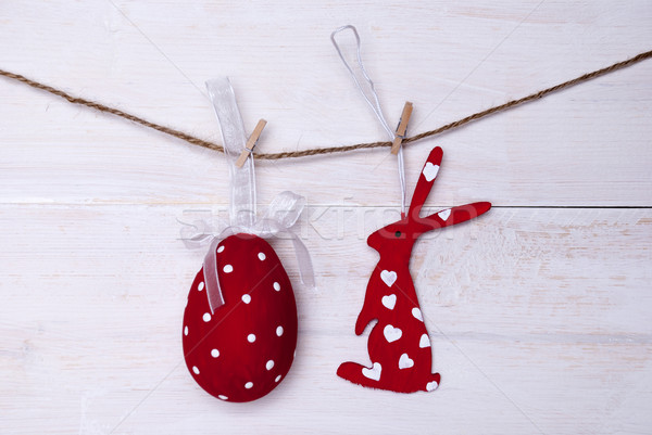 One Red Easter Bunny And Easter Egg Hanging On Line Stock photo © Nelosa
