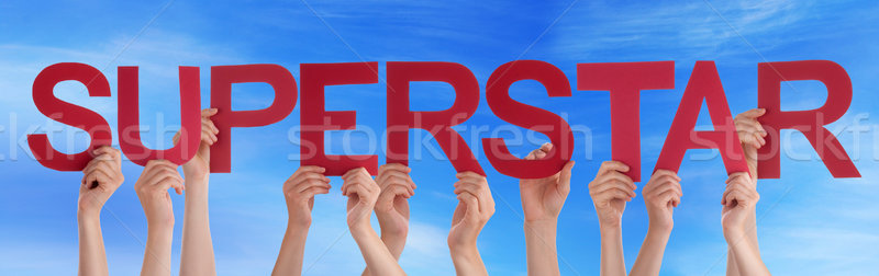 Hands Holding Red Straight Word Superstar Blue Sky Stock photo © Nelosa