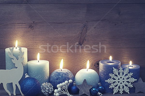 Vintage Christmas Card With Blue Candles, Reindeer, Ball Stock photo © Nelosa