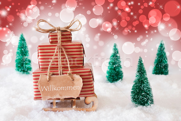 Christmas Sleigh On Red Background, Willkommen Means Welcome Stock photo © Nelosa