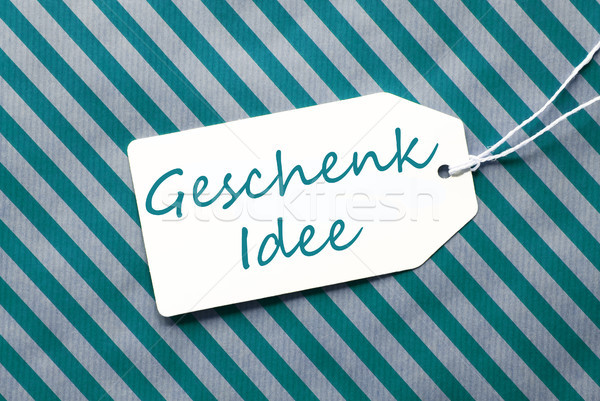 Label On Turquoise Wrapping Paper, Geschenk Idee Means Gift Idea Stock photo © Nelosa