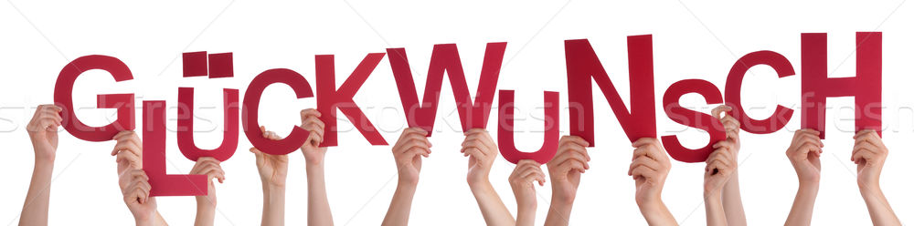 People Holding German Word Glueckwunsch Means Congratulation Stock photo © Nelosa