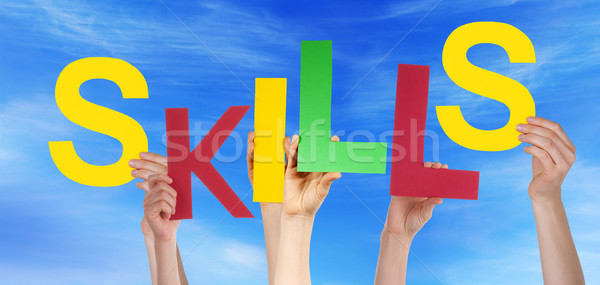 Many People Hands Holding Colorful Word Skills Blue Sky Stock photo © Nelosa