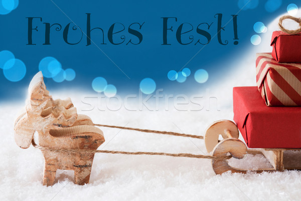 Reindeer With Sled, Blue Background, Frohes Fest Means Merry Christmas Stock photo © Nelosa