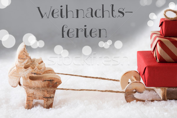 Reindeer With Sled, Silver Background, Weihnachtsferien Means Christmas Break Stock photo © Nelosa