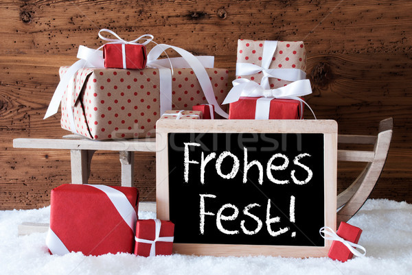 Sleigh With Gifts On Snow, Frohes Fest Means Merry Christmas Stock photo © Nelosa