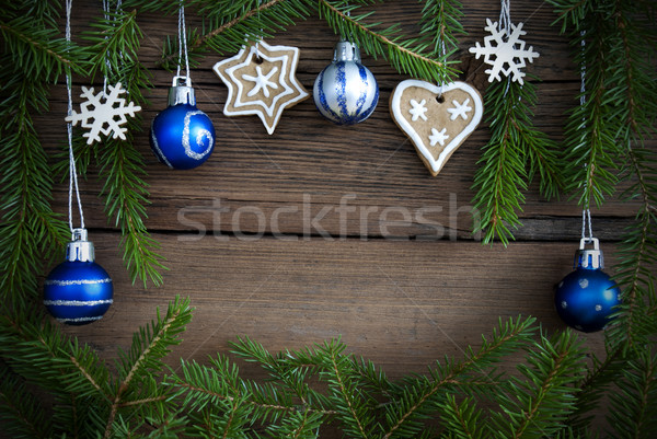 Stock photo: Fir Tree Branaches Framing Christmas Decoration on Wood