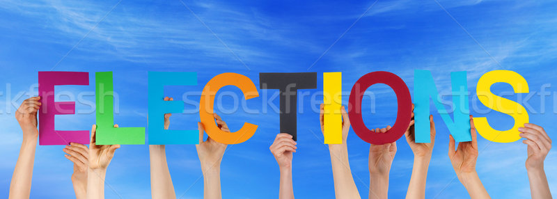 Many People Hands Holding Colorful Straight Word Elections Blue  Stock photo © Nelosa