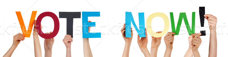 People Hands Holding Colorful Straight Word Vote Now  Stock photo © Nelosa