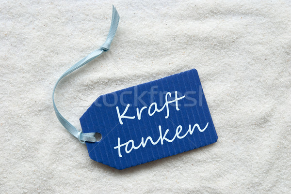 Kraft Tanken Means Recover On Blue Label Sand Background Stock photo © Nelosa