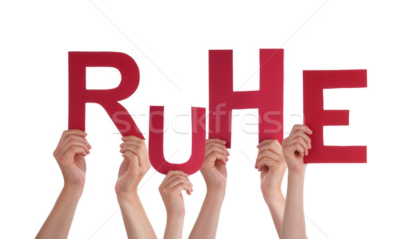 People Holding German Word Ruhe Means Rest  Stock photo © Nelosa
