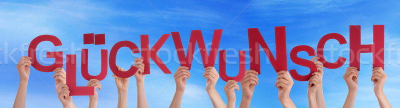 People Holding German Word Glueckwunsch Means Congratulation Blu Stock photo © Nelosa