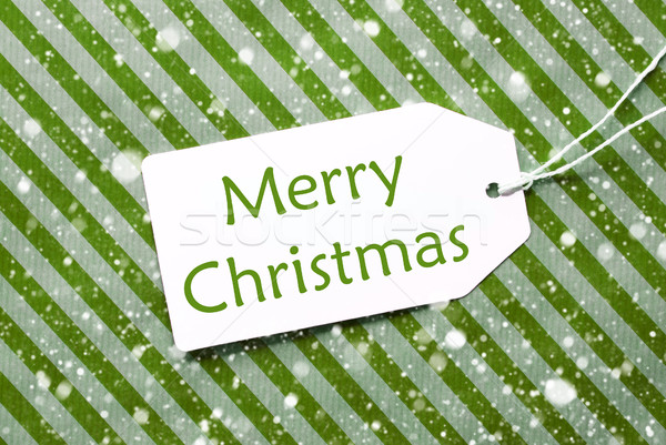 Label On Green Wrapping Paper With Snowflakes, Text Merry Christmas Stock photo © Nelosa