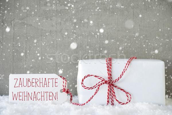 Ajándék cement hópelyhek mágikus karácsony egy Stock fotó © Nelosa