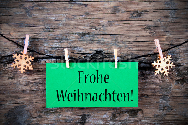 Green Tag with Frohe Weihnachten Stock photo © Nelosa