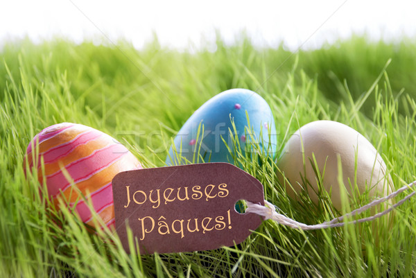 Happy Easter Background With Colorful Eggs And Label With French Text Joyeuses Paques Stock photo © Nelosa