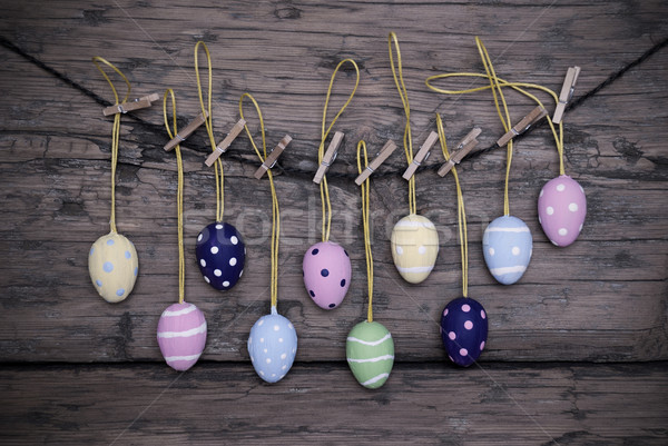 Many Colorful Easter Eggs Hanging On Line  With Frame Stock photo © Nelosa