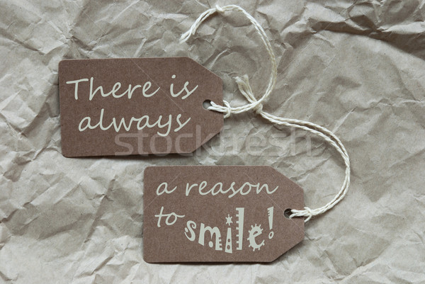 Two Brown Labels With Quote Always Reason Smile Paper Background Stock photo © Nelosa
