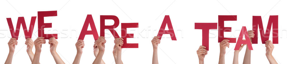 Hands Holding Red Word We Are A Team  Stock photo © Nelosa