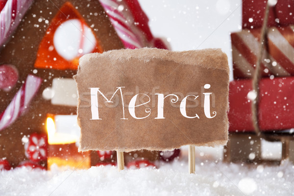 Gingerbread House With Sled, Snowflakes, Merci Means Thank You Stock photo © Nelosa