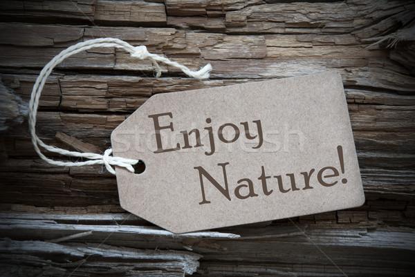 Enjoy Nature On Beige Label Stock photo © Nelosa