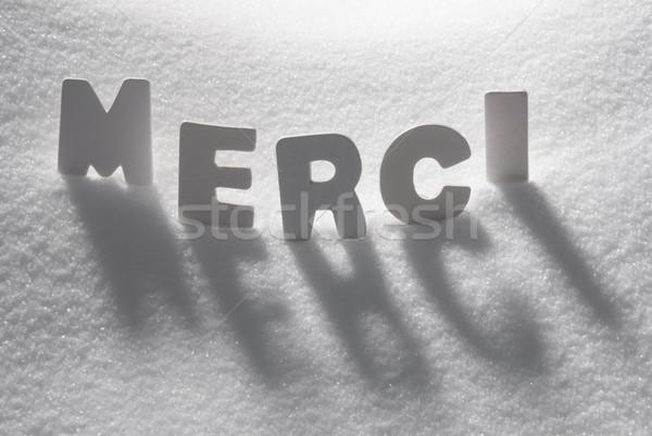 White Word Merci Means Thank You On Snow Stock photo © Nelosa