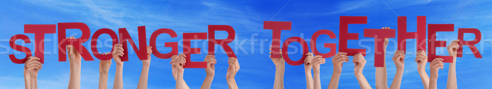 Many People Hands Holding Red Word Stronger Together Blue Sky Stock photo © Nelosa