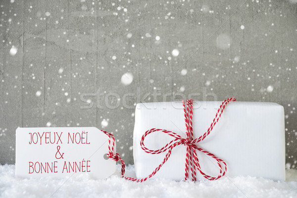 Gift, Cement Background With Snowflakes, Bonne Annee Means New Year Stock photo © Nelosa