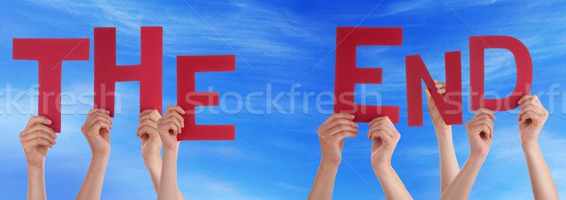 Emberek kezek tart piros szó befejezés Stock fotó © Nelosa