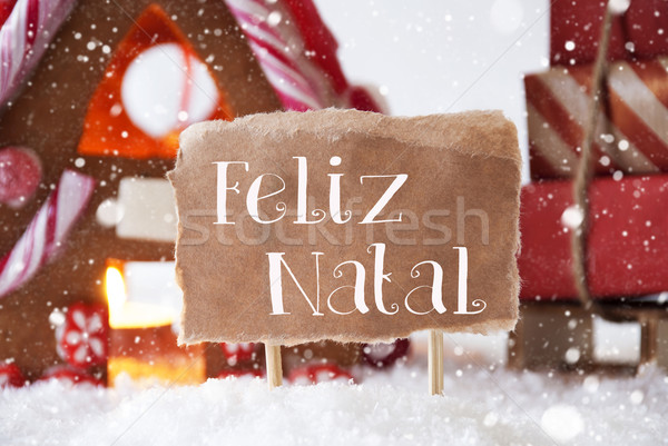 Gingerbread House With Sled, Snowflakes, Feliz Natal Means Merry Christmas Stock photo © Nelosa